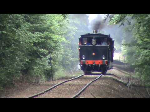 Danish steam train LJ 19 passes railroad crossing towards Maribo