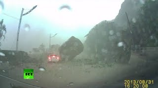 Dash cam video: Driver engulfed in Taiwan landslide, narrowly escapes huge boulder