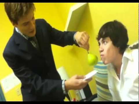 Justin Kelly feeding Munro Chambers a pear
