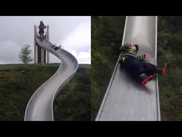 Kid Wipes Out On Slippery Slide | What's Trending Now