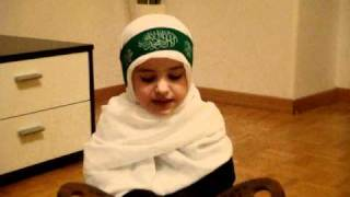 muslim kid reciting Quran (Al Fatiha)