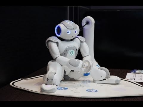 Aldebaran's NAO Robot with its new Developper only prototype of Charging Station