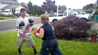 Kid gets punched in the face!!