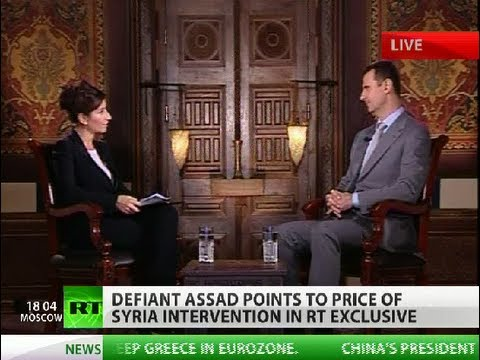 RT host on Assad exclusive interview background
