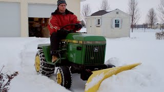getlinkyoutube.com-John Deere 318 plowing snow