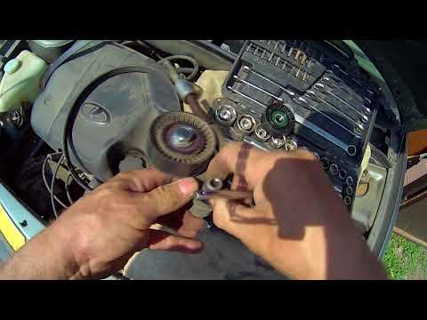 Заменить натяжной ролик ремня генератора Lada Kalina