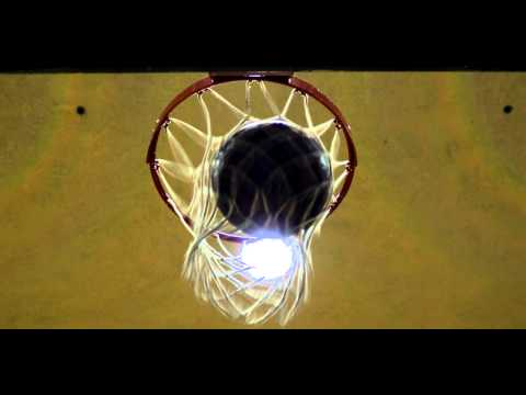 Royalty Free Stock Footage of Slow motion shot of a basketball going through the net.
