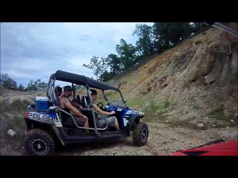 Several Polaris RZR SxS Models playing around in one of the gravel pits at Sandtown