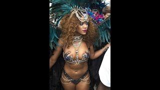 getlinkyoutube.com-Rihanna parades around in tiny sparkly bra and huge feather costume at Barbados festival