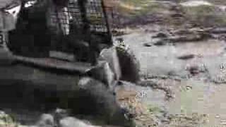 getlinkyoutube.com-McLaren Over-the-tire track for skid steer