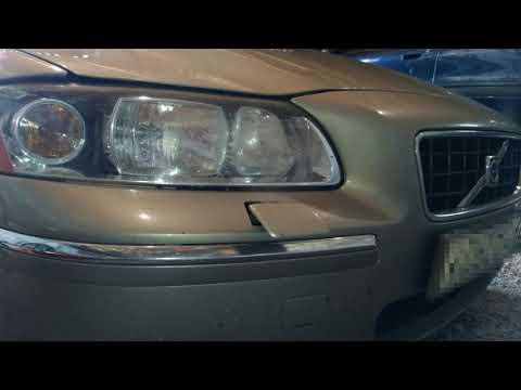 Volvo S60. Форсунка омывателя фары в работе.