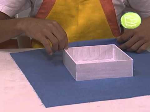 Aprenda fazer uma caixa de presente forrada com tecido.
