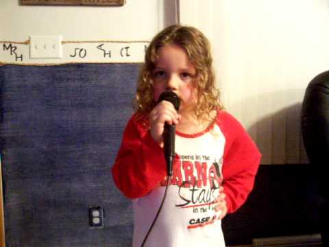 Taylor Swift's yougest fan...that can sing the words too!  :)