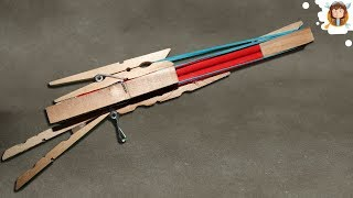 getlinkyoutube.com-How to make a rubber band gun - (Shoots three times)
