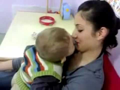 cute baby kiss attempt , very funny :)
