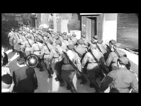 Czech soldiers march through the streets in Prague, Czechoslovakia. HD Stock Footage