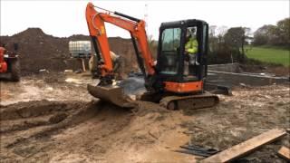 getlinkyoutube.com-Mini Excavator working with very wet mud.