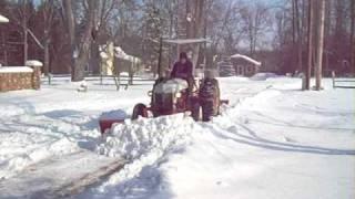 getlinkyoutube.com-Ford 9N Plowing Snow