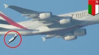 Surviving a plane crash: Small jet plunges as it flies under Emirates superjumbo - TomoNews
