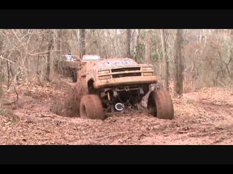 huge mud trucks with big blocks in deep ruts