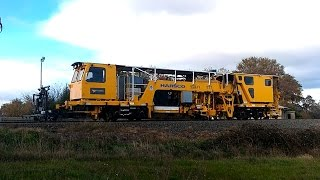 getlinkyoutube.com-TasRail Ballast Tamper and Regulator working on track alongside Youl Road