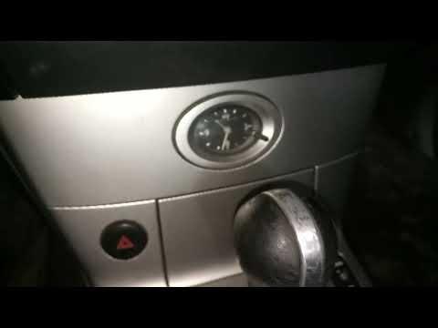 Где находится блок управления подушками безопасности у Инфинити QX56