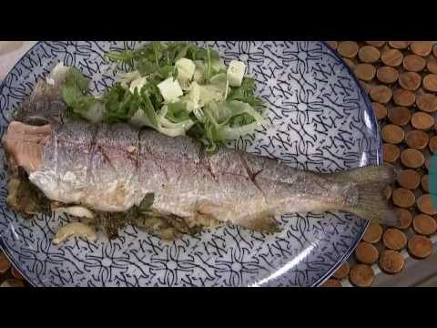 A whole spring trout stuffed with grilled lemons, cucumber + dill