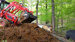 Kioti NX6010 cutting, digging hill & filling retaining wall