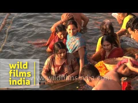 Hindu women bathing in the ganges to observe Shivratri, Varanasi