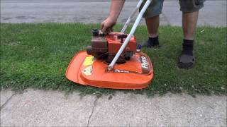getlinkyoutube.com-A 1980 Flymo hovering lawnmower Cold start and mowing