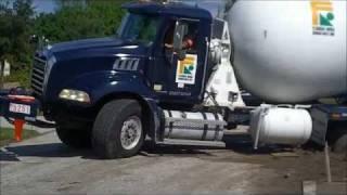 getlinkyoutube.com-Concrete Truck Loses Tires After Stuck in Mud