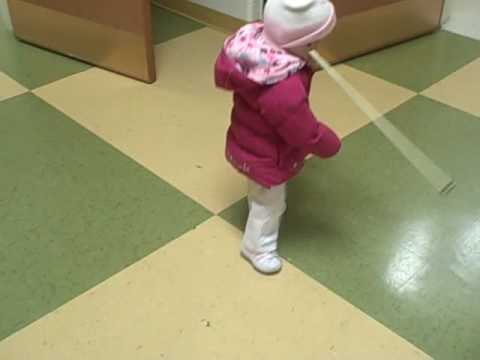 Toddler who is blind  uses cane to navigate and learn  her world