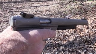 getlinkyoutube.com-Ruger MK II Suppressed Close-up