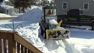 getlinkyoutube.com-john deere 1026R blowing back snow bank