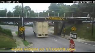 getlinkyoutube.com-Truck hits 11foot8 trestle as train is crossing