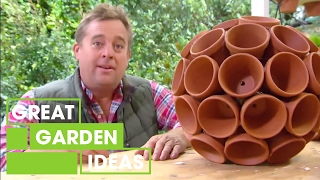 Jason creates some funky terracotta garden art