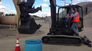 getlinkyoutube.com-Terrie Dunks A Basketball With A Mini Excavator