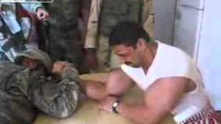 U.S. soldier and Iraqi soldier - Arm Wrestling