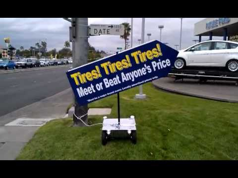 "Velocity Signs ""The Original Sign Waving Machine"" at Future Ford of Sacramento (Tire Sale!)"