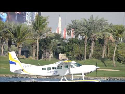 Taking off of Seawings seaplane on Dubai creek water.