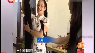 Kong Yan kept 2.2 meters long hair for 26 years