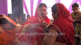 Indian women worship Goddess Durga during Durga Puja festival in Bihar
