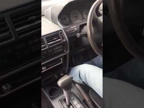 Где находится у Mitsubishi Chariot коробка передач