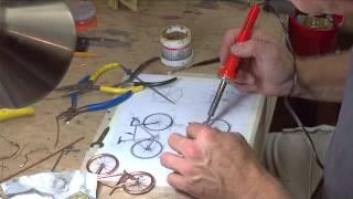 getlinkyoutube.com-Merlin Sculpture Creation Bicycle Wire Art