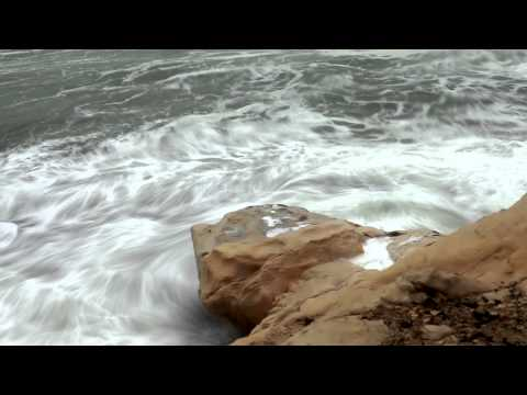Stock Footage of waves crashing against a rocky shore in Israel.