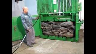 getlinkyoutube.com-Tire Baling with Hydraulic Tire Baler REC7242 TB