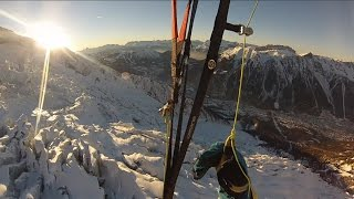 Sunset paragliding off the Aiguille du Midi, over the Bossons Glacier and down to Chamonix