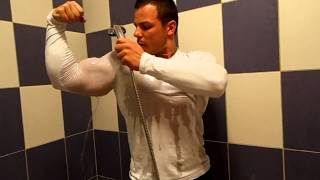 Gabriel MuscleDominus-Flexing big muscles with tight shirt in shower