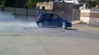 getlinkyoutube.com-Suzuki Swift Drift and burnout