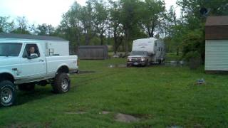 getlinkyoutube.com-Ford F150 pulls out stuck Chevy 2500 with camper